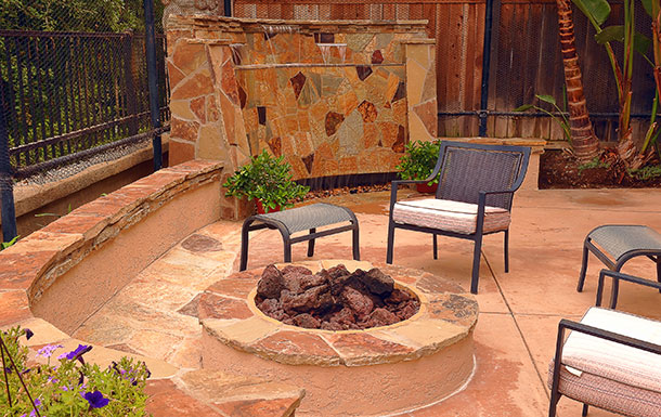 custom patio fire pit and waterfall