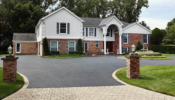 large house with asphalt driveway