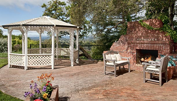 backyard gazebo with outdoor fireplace