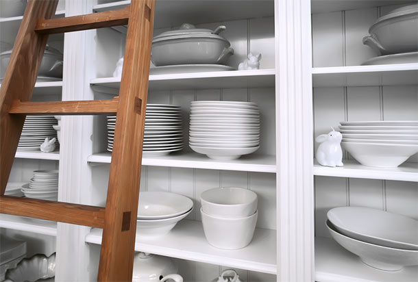 Open Kitchen Shelves With White Dishes
